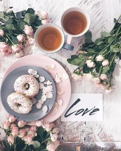 Tea and donut breakfast flatlay with roses - Love flatlay