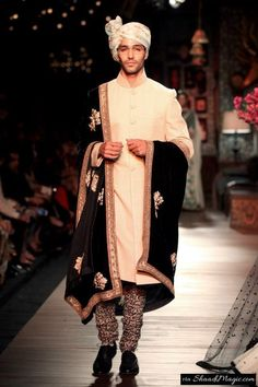 Black & White Sherwani  Another velvet stole with golden embroidery design for a plain off-white sherwani and a printed pants, can make a groom much perfect in his look for the day.