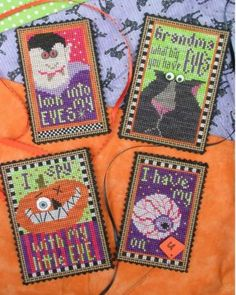 The Eyes Have It is the title of this cross stitch pattern from Val's Stuff that includes all four designs and six Just Another Button Company buttons.