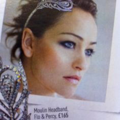 Found in a wedding magazine - I like the peacock feather diamanté hair clip and the make up.