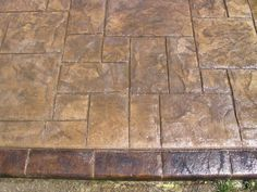 Grand Ashler Slate stamped concrete with acid staining on the boarder in OH