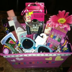 Birthday gift for little girl 7 yrs. Personalized Basket full of goodies like nail polish, nail polish remover, nail art, hair ties, Barbie band aids, bubble gum, lip gloss, princess tattoos, & a pair of dazzling sunglasses