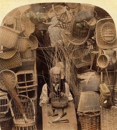 A basket maker...This interesting photograph of a basket maker is part of a stereoscope card. It has been gently hand tinted and shows him surrounded by a huge variety of work. I like the tools laid out in front.