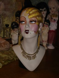 ********This is an 17 1/2 vintage fiberglass mannequin with approx. 21 1/2 head circumference that has been completely hand painted in a vintage