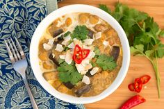 This South Indian coconut curry is made from aubergines, chickpeas, tomatoes, coconut milk and an array of spices which helps achieve a complex flavour.