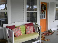 Crib turned into a porch bench! What a great re purpose idea!
