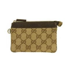 This compact coin purse made from Gucci iconic monogram fabric canvas and brown leather trim. Featuring silvertone metal hardware and D-ring so you can attach Gucci Monogram, Pouch, Wallet, Simple Shapes, Brown Leather, Coin Purse, Essentials, Metal, Mini
