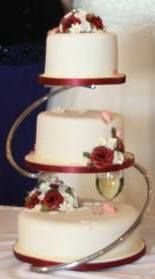 A Midsummer Night Dreams   Wedding cake with flowerpaste sweet peas     Three tier cake stand turns three cakes in different sizes into a layered wedding  cake
