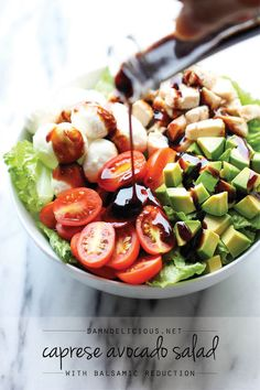 Caprese Avocado Salad - A light, refreshing salad loaded with mozzarella, tomatoes, basil and avocado with a sweet balsamic reduction!
