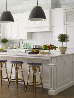 like the industrial pendants in the classic white kitchen.