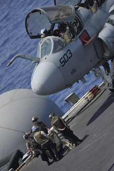 """RED SEA (Sept. 7, 2013) – Sailors prepare an EA-6B Prowler assigned to the """"Gray Wolves"""" of Electronic Attack Squadron (VAQ) 142 for flight operations on board the aircraft carrier USS Nimitz (CVN 68). Nimitz Strike Group is deployed to the U.S. 5th Fleet area of responsibility conducting maritime security operations and theater security cooperation efforts. (U.S. Navy photo by Mass Communication Specialist Seaman Kole E. Carpenter/ Released)"""
