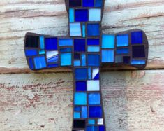 Small Cross covered with a mix of blue tiles Cross measures 8 by 5 inches tall and are cut from inch birch Comes with a keyhole hanger Sea Glass Art, Stained Glass Art, Mosaic Glass, Mosaic Crosses, Wall Crosses, Mosaic Crafts, Mosaic Projects, Mosaic Ideas, Stain Glass Cross