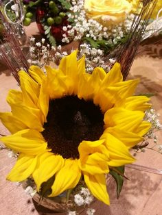 Sunflower with baby's breath and wheat in small vase