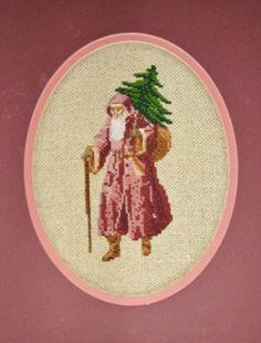 Old  world Santa carrying a Christmas tree.