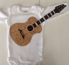Guitar Onesie. After seeing this pic, I have only been this excited to have my own kids once before.