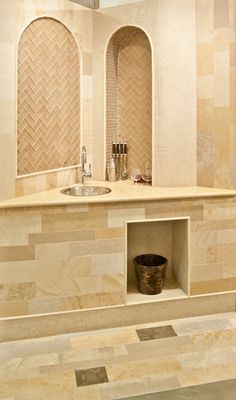Artistic Tile | Our French Limestone adds sophistication to any small space, including this wet bar.
