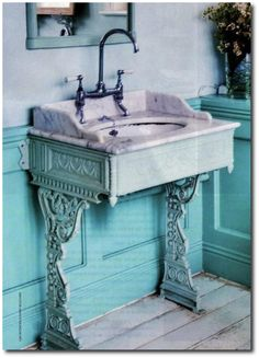 Wow. The designer took two antiques - neither of which held a significant value - combined them to create this amazing one-of-a-kind, beautiful conversation piece. What a sink!