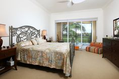 Master bedroom with view of the lake and lush landscaping.