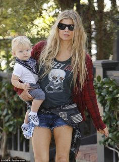 Pin parade: Fergie got leggy in Daisy Dukes while on a sunny Brentwood stroll with her son...