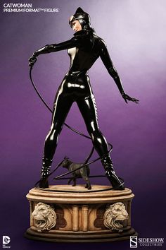 Selina Kyle is ready to crack the whip on the Catwoman Premium Format Figure, giving a playful look over shoulder, as if daring Batman to try and catch her.  This 23-inch-tall. limited-edition statue features Gotham City's sexiest cat burglar wearing a glossy, black, fitted jumpsuit and night-visi