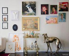 gallery wall +vintage bar cart + metal dog