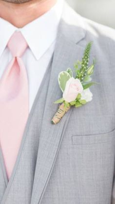 This is a pink rose boutonniere comes complete with attachment pins and individually wrapped.