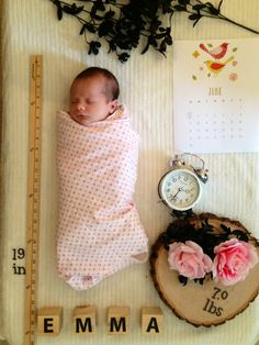 This visual birth announcement cleverly uses objects to communicate the details of baby's birth (name, date, time, height, weight). The roses and greenery add a delicate and gracious touch.