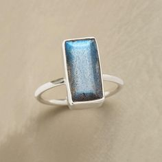 SPARKLING CONVERSATION RING--Our exclusive, handmade ring suggests a sterling silver banquet table laid with labradorite, the stone's iridescence sparking lively conversations. Handcrafted in whole sizes 5 to 10.