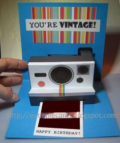 Polaroid Camera Pop Up Card Papercraft - by Extreme Cards -- A beautiful Pop Up card of a vintage Polaroid camera, with templates to download and a very detailed tutorial, by Extreme Card & Papercrafting website.