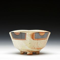 Jeff Oestreich  Description: thrown and altered soda fired stoneware with multiple glazes