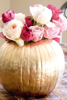 Let your pumpkins shine with a metallic finish and ladylike flowers, placed in a cup in the center, for a dainty table topper. Get the tutorial at Vintage Romance Style. Pumpkin 1st Birthdays, Pumpkin Birthday Parties, Pumpkin First Birthday, Pumpkin Birthday Cakes, Holiday Centerpieces, Baby Shower Centerpieces, Baby Shower Decorations, Wedding Centerpieces, Holiday Decorations