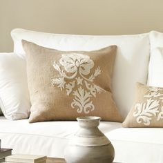 """one beautifully textured design in this 26"""" Pillow Cover. The oversized damask pattern is hand embroidered over natural burlap for a bold look rendered in warm, neutral tones"""