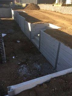 Pioneer smooth grey concrete sleeper retaining walls For backyard slope Concrete Patios, Concrete Sleeper Retaining Walls, Concrete Sleepers, Backyard Retaining Walls, Retaining Wall Design, Building A Retaining Wall, Sloped Yard, Sloped Backyard, Backyard Landscaping