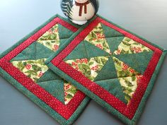Set of two hot pads in Christmas fabrics of green, red and gold. Binding is hand stitched for a nice finish. I have quilted the center in a square. Backing is white Christmas print . I have used Insul-bright batting to protect from the heat and one layer of warm & natural batting. Size is 8 by 8 inches All fabrics 100% cotton Batting is warm and natural and prewashed Insul Bright to insulate the pad and protect your hands from the heat Made in my home which is smoke free and pet free T...