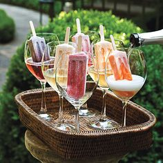 Prosecco & Popsicles  -  Doesn't get any simpler than this. I saw Bobby Flay doing it on TV last night over sorbet in a martini glass.  I think I'd use Creamsicles and home-made berry pops.