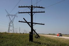A traveler passes by new and old power lines along historic U.S. Route 66 June 13, 2007 near Dwight, Illinois.