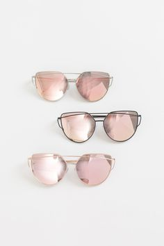 """These mirrored sunglasses are so retro chic yet feminine! We love the rose gold mirror finish and metal frame on these must have statement sunnies! Sunglasses measure 6"""" x 2.25"""". All sunglasses are fi"""
