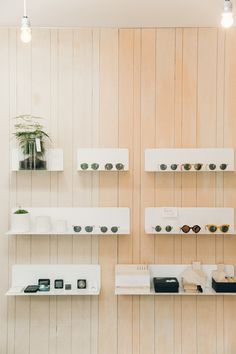 The clean lines of the interior of Brighton boutique Workshop. Simple visual merchandising works so well against the natural wooden features and shelving.