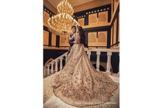 Bathed in the glow of the grandiose crystal chandelier, the bride looked like the golden princess that she is. Couple Portraits, Wedding Portraits, Golden Princess, India Wedding, Flower Shower, Modern Love, Bride Look, Photography And Videography, Beautiful Couple