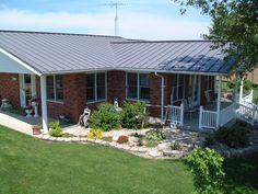 Grey painted metal roof with red brick