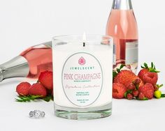 ***Pink Champagne*** A fruity and shimmering scent, this bouquet melds notes of raspberry, strawberry, violet and mandarin with warm accents of vanilla and spun sugar. It's bright tones and lively aroma are an ode a frosty glass of bubbly and a sparkling toast to love!  Signature Collection ($15 - $7500 hidden jewel) Each Signature Pink Champagne Candle contains one mystery ring valued at $15 to $7,500. This candle features a higher minimum jewelry value than our Classic Collection.