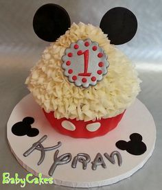 "Mickey Mouse themed 10"" tall 1st birthday smash cake."