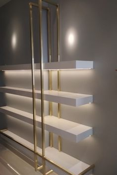 Brass box section fixed on to the wall shelves to bring out it's elegance. Home Decor Hooks, Home Entrance Decor, Home Office Shelves, Home Office Decor, Home Spa Room, Wood Wall Design, Gold Shelves, Table Decor Living Room, Salon Interior Design