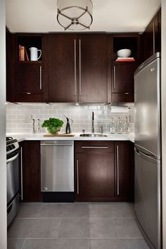 21 Chocolate Kitchen Ideas Interiorforlife.com Run cabinets to the ceiling