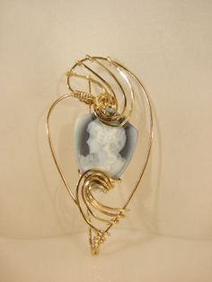 Get 50% off only until January 8th. Use the code Birthday. Wire Wrapped Gold Filled Ultrasonic Carved Agate Cameo Brooch