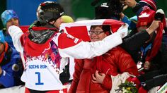 Gold medalist Alex Bilodeau celebrates with his brother Frederic after the flower ceremony for the men's moguls finals on day three of the Sochi 2014 Winter Olympics.