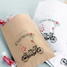 Whimsically styled with a tandem bicycle design and the phrase 'Enjoy The Ride' these 5 x 7 paper treat bags personalized with the bride and groom's name are perfect for guests to fill up with sweet treats at your wedding candy buffet for easy take home gifts. These candy and favor bags can be ordered at http://myweddingreceptionideas.com/personalized_tandem_bicycle_treat_bags.asp