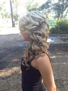 Lovely long thick blonde curls with brown low lights