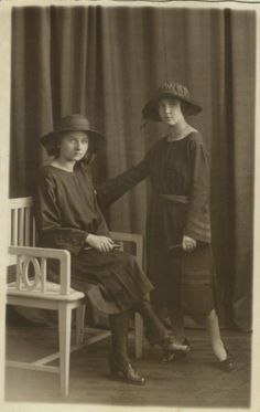 Why don't these women smile? This antique real photo postcard shows two fashionable young women, circa 1910.