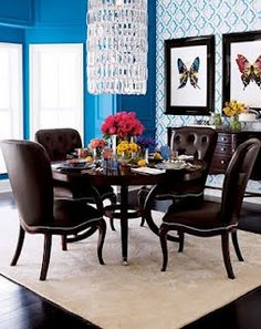 comfy electric blue dining room with a pretty chandelier for frosting